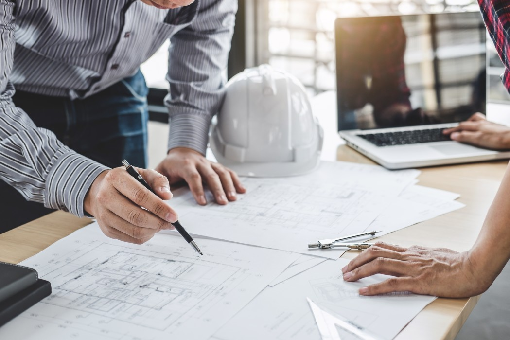 architecture-engineer-teamwork-meeting-drawing-and-working-for-architectural-project-and-engineering_t20_yXrQXL